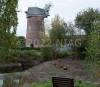 Hough Mill with a drained pond in the foreground